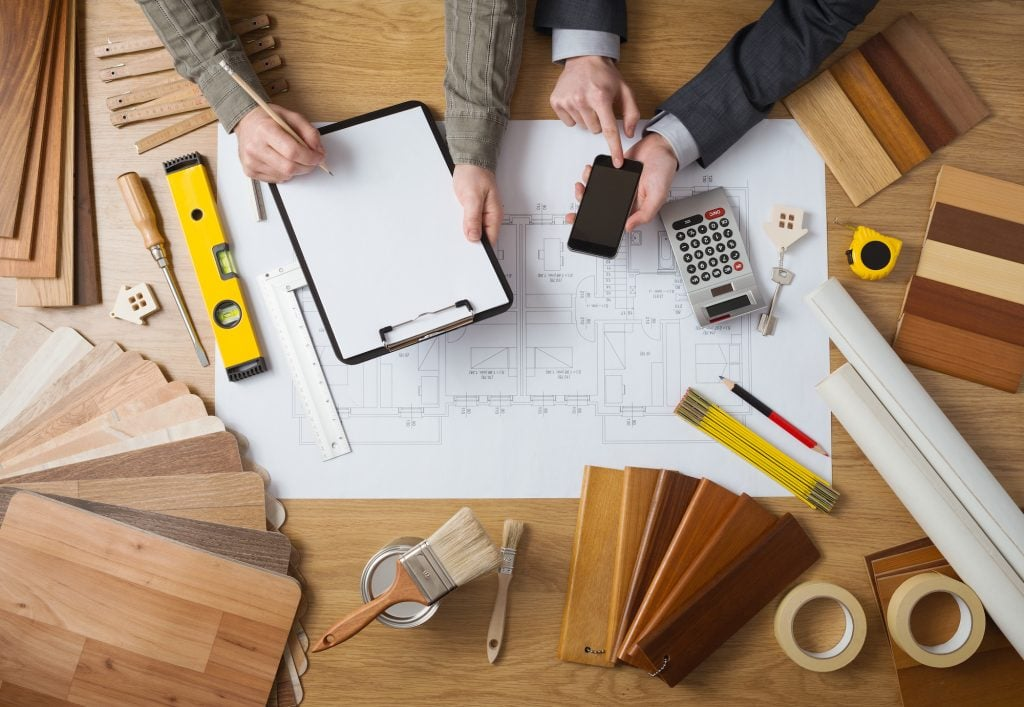 quantity surveyor with plans and calculator
